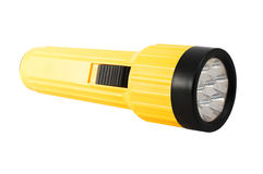 Torch on a white background. Yellow plastic torch flashlight isolated on white Royalty Free Stock Photo