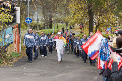 Torchbearer carries the Olympic flame Royalty Free Stock Photo