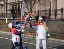 Torchbearer carries the Olympic flame. Royalty Free Stock Images