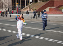 Torchbearer carries the Olympic flame. Stock Photography