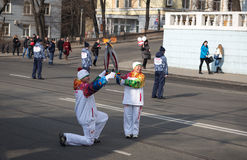 Torchbearer carries the Olympic flame. Stock Photo