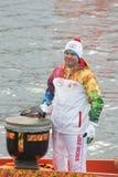 Torchbearer Ignat Kovalev on a boat Royalty Free Stock Photo