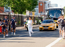 Torchbearer olímpico 2012 Fotografia de Stock Royalty Free
