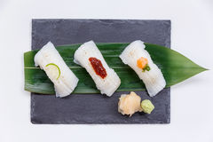 Torched Engawa Sushi Topping with Lime, Chilli Jam and Minced Daikon Served with Wasabi and Prickled Ginger. Royalty Free Stock Images