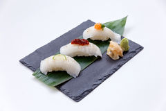 Torched Engawa Sushi Topping with Lime, Chilli Jam and Minced Daikon Served with Wasabi and Prickled Ginger. Stock Image
