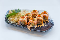 Torched Salmon Roll with Prawn Tempura Inside.Topping with Cheese, Ebiko Prawn Eggs, Scallion and White Sesame.  Stock Image