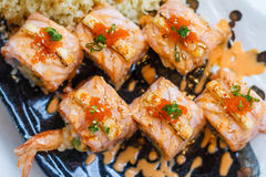 Torched Salmon Roll with Prawn Tempura Inside.Topping with Cheese, Ebiko Prawn Eggs, Scallion and White Sesame.  Royalty Free Stock Images