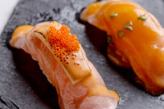 Torched Salmon Sushi Topping with Cheese and Ebiko Shrimp Egg Served on Black Stone Plate. Sushi Set : Torched Salmon Sushi Topping with Cheese and Ebiko Shrimp Stock Images