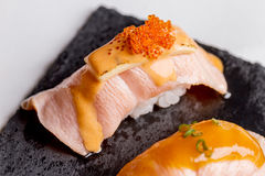 Torched Salmon Sushi Topping with Cheese and Ebiko Shrimp Egg Served on Black Stone Plate. Sushi Set : Torched Salmon Sushi Topping with Cheese and Ebiko Shrimp Royalty Free Stock Image