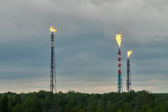 Torches for burning of associated gas oil plant Royalty Free Stock Photos