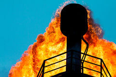 Torches for casing-head gas. Flaring during oil, Russia stock image