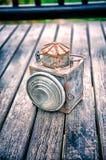 Torcia d'annata su vecchia struttura di legno del pavimento Fotografia Stock