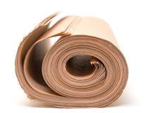 Torcido en el papel de embalaje marrón del rollo Foto de archivo libre de regalías
