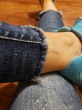 Tore Jean fabric pants and shoes. Girl, legs, rip, ripped, scratched, style, fashionable, tennis, relax, frayed, active stock photo