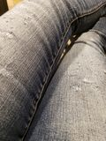 Tore Jean fabric pants. Girl, legs, rip, ripped, scratched, style, fashionable stock photos