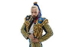 Toreador nel vestito dell'oro e del blu o torero spagnolo tipico isolato sopra bianco fotografia stock