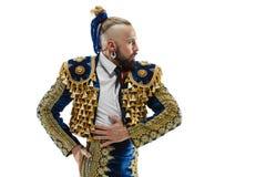 Toreador nel vestito dell'oro e del blu o torero spagnolo tipico isolato sopra bianco immagini stock