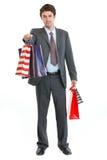 toreb ręki mężczyzna zakupy rozciągania kostium Zdjęcia Royalty Free