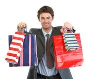 toreb ręki mężczyzna zakupy rozciągania kostium Obrazy Royalty Free