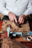 Toreedor rolling hand made cigars Stock Photography