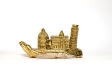Toren van Pisa op gouden hand/Italië Stock Afbeeldingen