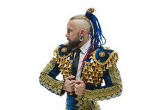 Torero in blue and gold suit or typical spanish bullfighter isolated over white. Studio background. The taming, achieving the goal, mortification, conquest stock photography