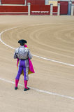 Torero holding cape. Torero holding his cape is waiting for the bull Stock Image