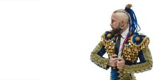 Torero w błękicie i złocisty hiszpański bullfighter odizolowywający nad bielem kostiumu lub typowego zdjęcia stock