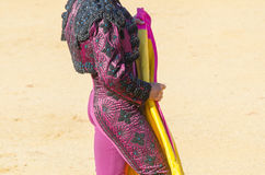 Torero waiting for the bull. A bullfighter awaiting for the bull in the bullring. Corrida de toros Stock Photos