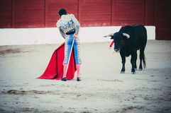 Torero waiting for the bull. A bullfighter awaiting for the bull in the bullring. Corrida de toros Royalty Free Stock Image