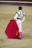 Torero in white costume waiting for the bull. A bullfighter in white costume awaiting for the bull in the bullring. Corrida de toros Stock Image