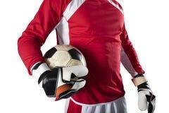 Torhüter hält den Ball im Stadion während eines Fußballspiels Auf wei?em Hintergrund stockbilder