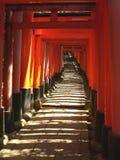 Torii at Fushimi Inari Shrine. Famous torii (gates) at Kyoto's Fushimi Inari Shrine stock image