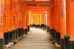 Torii at Fushimi Inari shrine with characters Royalty Free Stock Photos