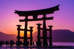 Torii Gate of Itsukushima Shrine. The great O-Torii of Itsukushima Shrine. Tourists walk around the famous tori gate of the Itsukushima Shrine on Miyajima Island stock photos