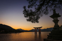 Torii gate at Miyajima, Hiroshima, Japan in Twilight time Stock Photos