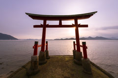 Torii gate of a shrine and sea Stock Photography