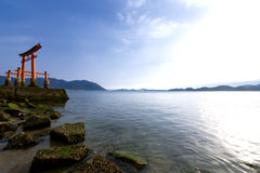 Torii gate of a shrine and sea Stock Image