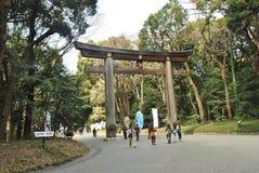 The Torii Gate standing at the entrance to Meiji Jingu Shrine. Tourist visit The Torii Gate standing at the entrance to Meiji Jingu Shrine.TOKYO, JAPAN royalty free stock photos