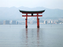 Floating Torii gate. View of the Torii gate standing in the middle of the sea in Miyajima Island, Japan as if floating on water royalty free stock photo