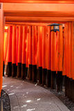 Torii gates in Kyoto, Japan. Torii gates at Fushimi Inari Shrine in Kyoto, Japan. Inari is seen as the patron of business, and merchants and manufacturers have Stock Photo
