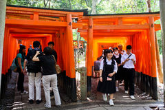 Torii Gates of Fushimi Inari Shrine. Some of the many Torii Gates in the Fushimi Inari Shrine, a shrine dedicated to Inari - the Shinto god of rice. Located in Stock Photo