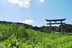 Torii and grassland Stock Photography