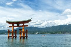 Torii of Itsukushima Shrine in daylight stock images
