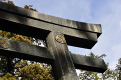 Torii with the Tokugawa crest. A closeup of a wooden torii (gate) bearing the Tokugawa family crest. This gate is located in Toshogu, Nikko, Toshigi prefecture royalty free stock photos