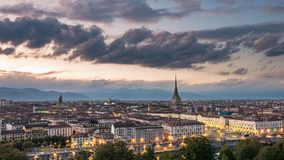 Torino Cityscape, Italia. Skyline panoramic view of Turin, Italy, at dusk with glowing city lights. The Mole Antonelliana illumina Royalty Free Stock Photo