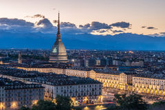 Torino Cityscape, Italia. Skyline panoramic view of Turin, Italy, at dusk with glowing city lights. The Mole Antonelliana illumina Stock Photo