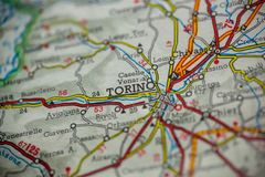 Torino Italy Map. Torino, Italy is the center of focus on an old map stock photography