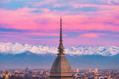 Torino Turin, Italy: cityscape at sunrise with details of the Mole Antonelliana towering over the city. Scenic colorful light on Stock Images