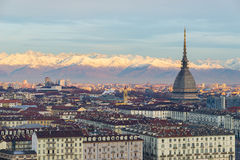 Torino Turin, Italy: cityscape at sunrise with details of the Mole Antonelliana towering over the city. Scenic colorful light on Royalty Free Stock Photos